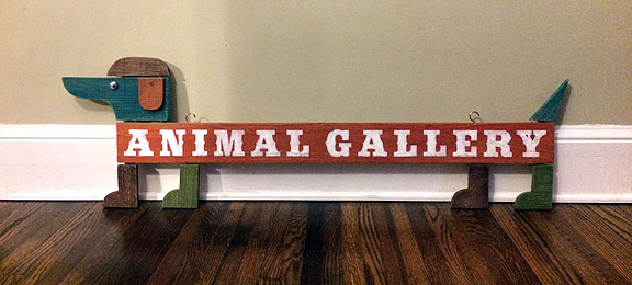 four dogs pet supply wooden sign - scott partridge